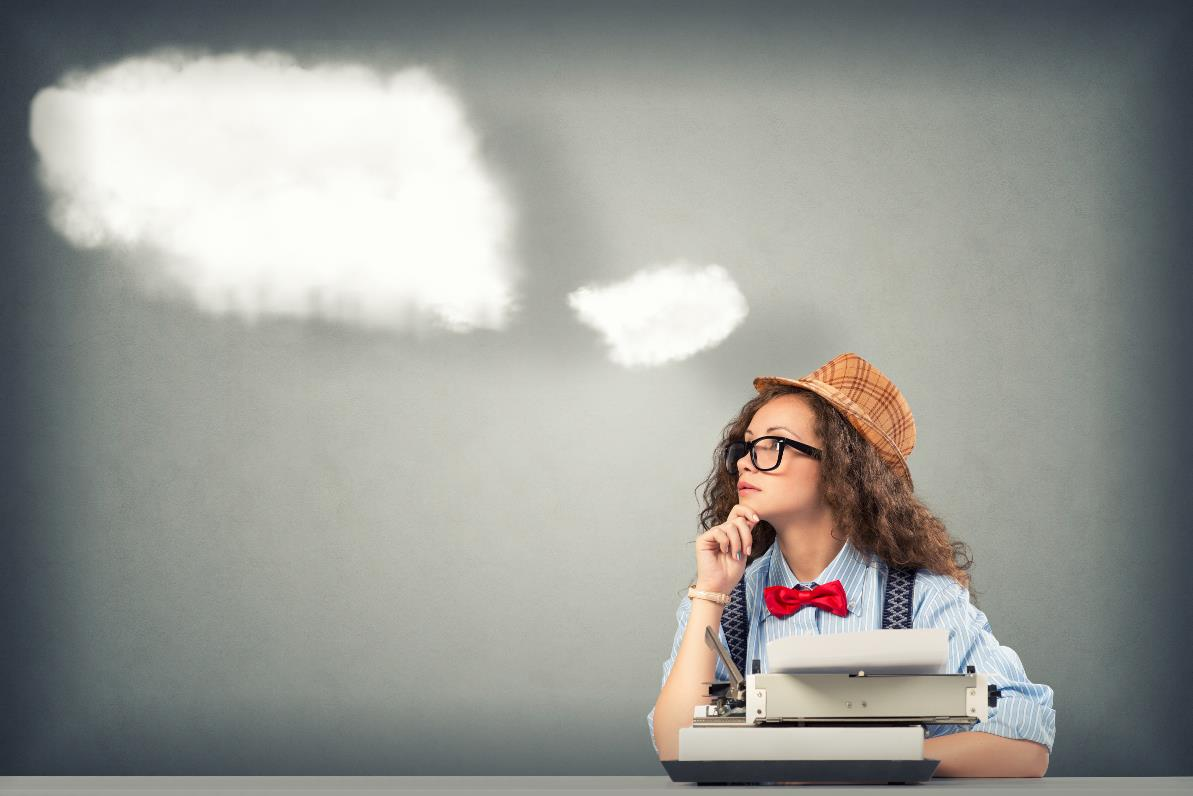 Writer with thought clouds
